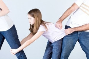 Parents punishing a girl